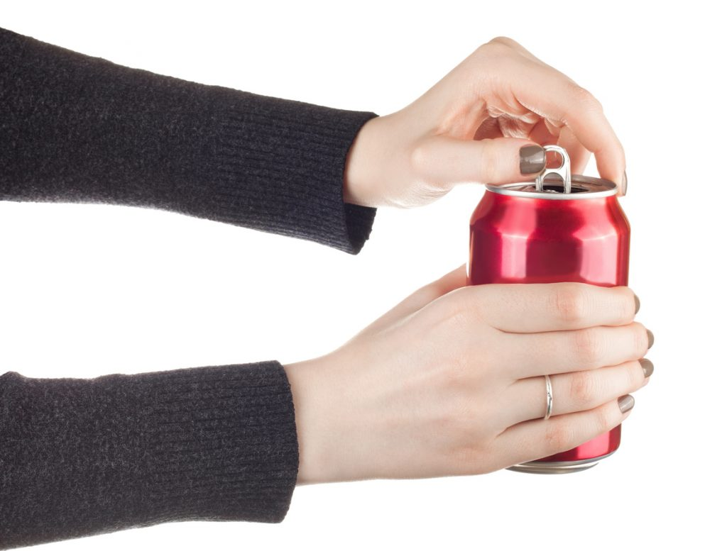 female hands opening a can of soda