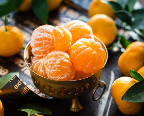 a bowl filled with peeled clementines