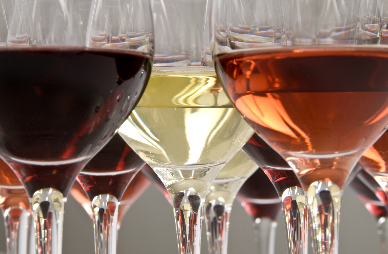 Red, rosé and white wine in crystal glasses