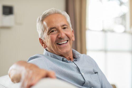 Portrait of happy senior man smiling at home.